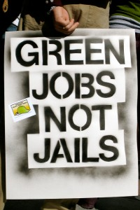 "Sign that reads, ""Green jobs not jails."""